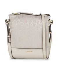 Calvin Klein Jeans - Natural Marina Logo Flat Crossbody Women's Shoulder Bag In Beige - Lyst