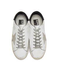 Golden Goose Deluxe Brand White & Black Superstar Sneakers for men