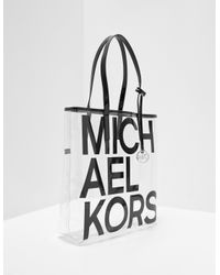 f8433272ec Michael Kors. Women's Black The Michael Large Graphic Logo Print Clear Tote  Bag