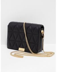 Lyst - Michael Kors Womens Jade Quilted Clutch Bag Black gold in Black 3a58dd0bb8