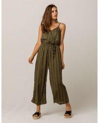 8087fe2f5237 Lyst - Mimi Chica Stripe Surplice Front Womens Jumpsuit in Green