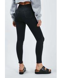 TOPSHOP - Moto Washed Black Joni Jeans - Lyst