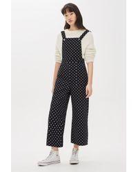 dbef561b86c Lyst - TOPSHOP Polka Dot Jumpsuit in Black