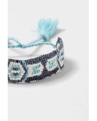 TOPSHOP | Black Triangle Beaded Tassel Bracelet | Lyst