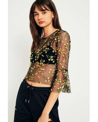 76ad8cb7e86b99 Urban Outfitters. Yellow Embroidered Mesh Romantic Fluted Sleeve Top ...