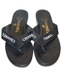da86c861fd2032 Lyst - Chanel Pre-owned Leather Flip Flops in Black