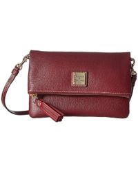 Dooney & Bourke - Red Saffiano Fold-over Zip Crossbody - Lyst