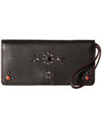 35851faac695 Lyst - COACH Western Rivets Slim Wallet in Black
