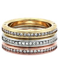 Michael Kors | Metallic Tri-tone And Pave Logo Grommet Stack Ring Set | Lyst