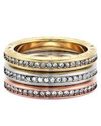 Michael Kors | Metallic Tri-tone And Pave Logo Grommet Stack Ring Set | Lyst