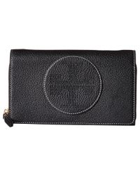 54f3aecba56 Lyst - Tory Burch Perforated Logo Flat Wallet Crossbody in Black
