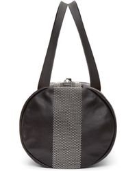 Alexander McQueen - Black Studded Leather Duffle Bag - Lyst