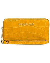 MICHAEL Michael Kors Leather Large Multi-Function Phone Case yellow - Lyst