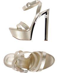 Casadei Sandals gold - Lyst