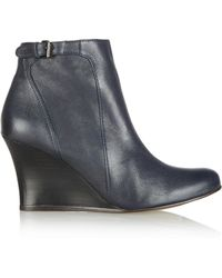 Lanvin Buckled Leather Wedge Boots - Lyst
