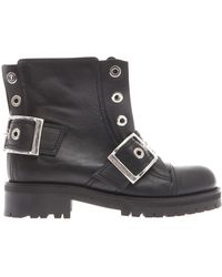 Alexander McQueen Buckled Leather Biker Boots - Lyst