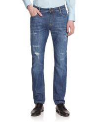 Versace Slouchy Distressed Denim Jeans blue - Lyst