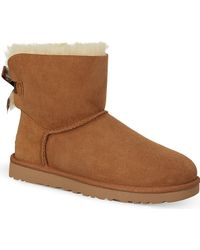Ugg Mini Bailey Bow Sheepskin Ankle Boots - For Women - Lyst
