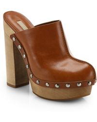 Michael Kors Perri Runway Studded Leather Clogs - Lyst