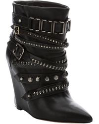 L.a.m.b. Black Leather Thacker Strappy Buckle Accent Wedge Midankle Boots - Lyst