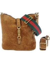 Gucci Under-Arm Bags beige - Lyst