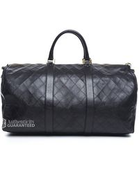 Chanel Pre-owned Black Lambskin Quilted Large Duffle Bag - Lyst