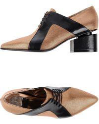 Stephen Venezia Lace-Up Shoes gold - Lyst