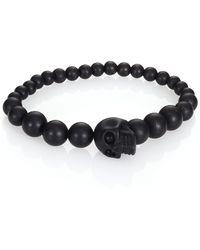 Alexander McQueen Beaded Skull Bracelet black - Lyst