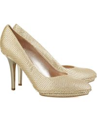 Calvin Klein Perforated Metallic Leather Pumps - Lyst
