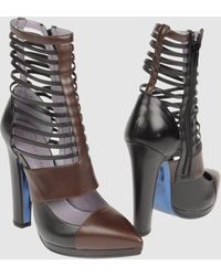 Versace Ankle Boots - Lyst