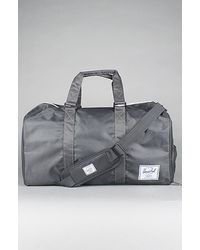 Herschel Supply Co. The Novel Duffle Bag in Charcoal - Lyst