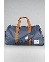 Herschel Supply Co. The Novel Duffel Bag in Navy & Tan - Lyst