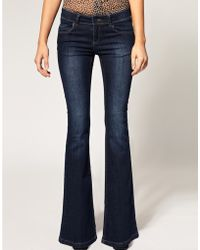 ASOS - Asos Petite Exclusive Mid Rise Flare Jeans - Lyst