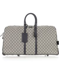 Gucci Large Leather-trimmed Canvas Travel Bag - Lyst