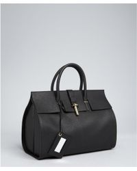 Balenciaga Black Pebbled Leather Tube Round Tote - Lyst
