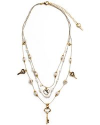 Betsey Johnson Bead And Key Illusion Necklace beige - Lyst
