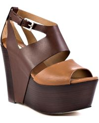Report Signature Tintle brown - Lyst