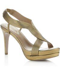 e5a3c462baf Lyst - Women s Elie Tahari Heels Online Sale