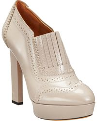 Givenchy Wingtip Platform Shoe Bootie - Lyst