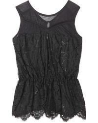 Nina Ricci Lace Top with Peplum black - Lyst