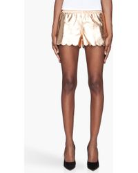 Versus  Gold Leather Tap Shorts - Lyst