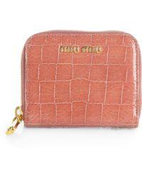 Miu Miu Embossed Leather Ziparound Wallet - Lyst