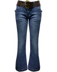 Jane Norman Belted Flare Jeans - Lyst