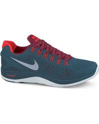 1ccd68185a0 Nike - Lunarglide 4 Shield Sneakers - Lyst
