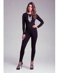 Bebe Cloverleaf Cut Out Jumpsuit - Lyst