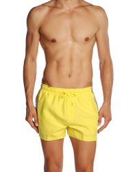 Calvin Klein Yellow Swimming Trunks - Lyst