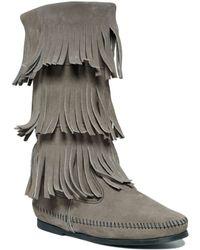 Minnetonka Three Layer Fringe Boots - Lyst