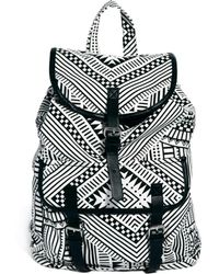 Monki | Elda Canvas Graphic Backpack | Lyst