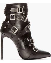 Saint Laurent Black Leather Buckled Paris Boots - Lyst