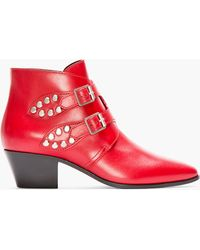 Saint Laurent Red Studded and Buckled Leather Rock Boots - Lyst